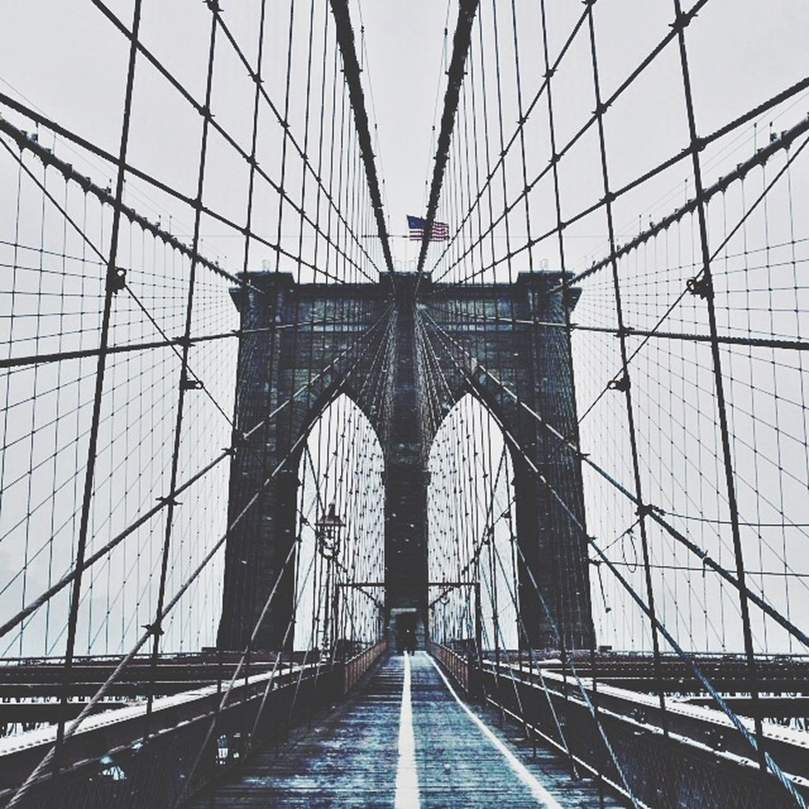 connection, bridge - man made structure, built structure, transportation, architecture, engineering, suspension bridge, the way forward, bridge, diminishing perspective, cable-stayed bridge, long, sky, vanishing point, travel destinations, low angle view, travel, clear sky, cable, famous place