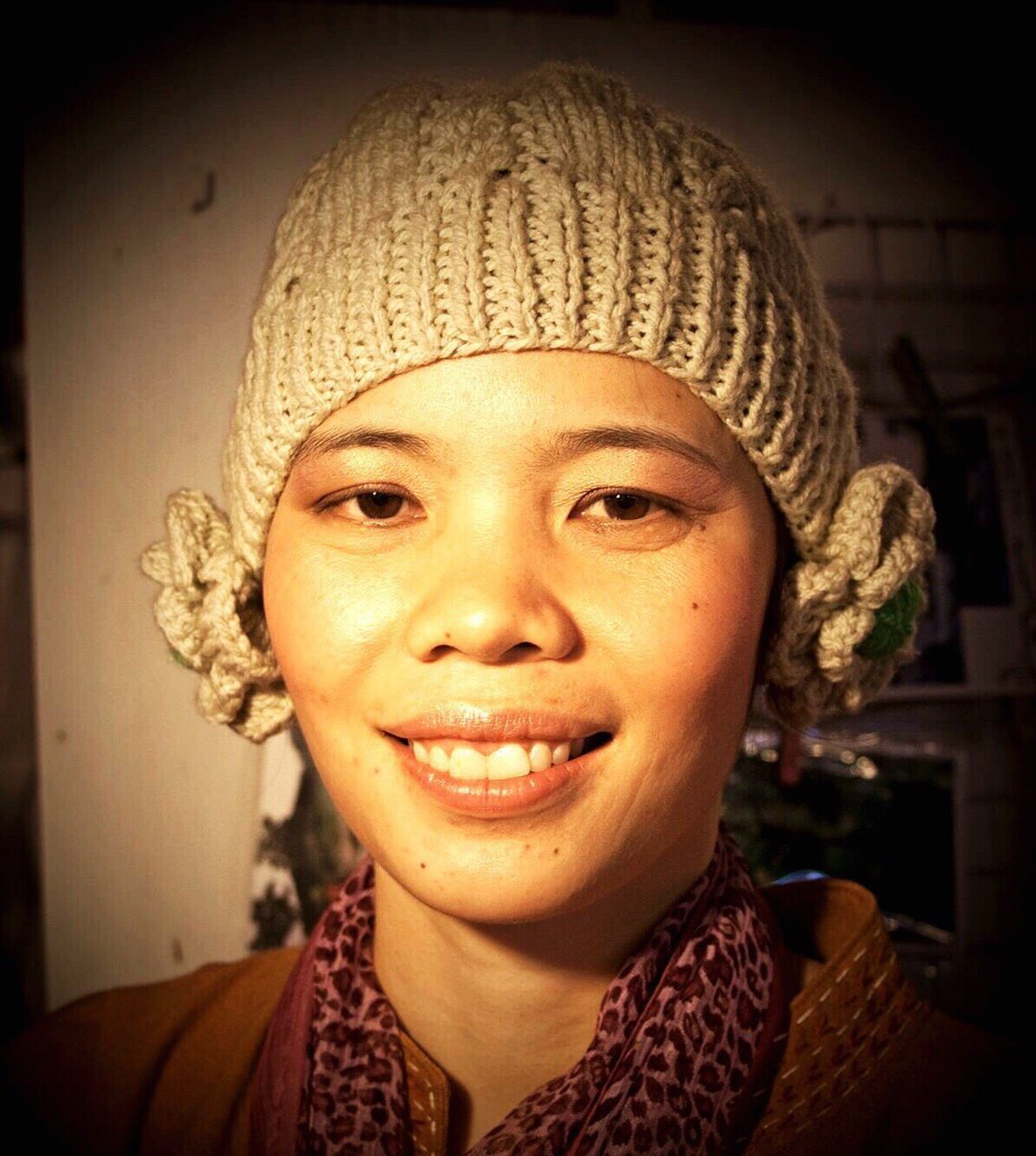 looking at camera, portrait, smiling, real people, front view, headshot, one person, knit hat, happiness, close-up, young adult, young women, indoors, human face, cheerful, day, people