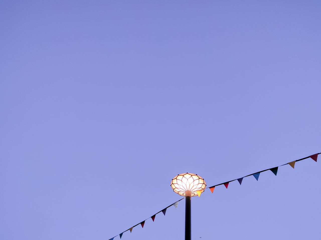 Carneval Carnival Clear Sky Copy Space Day Decoration Electricity  Flags Illuminated Light Post Lighting Equipment Low Angle View Minimal No People Outdoors Park Pastel Sky Street Light Triangles