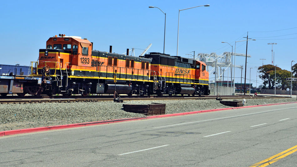 BNSF Locomotive 4 Railway Port Of Oakland, Ca. 2nd Largest Freight Railroad In North America Burlington Northern & Santa Fe Railway Merged 1996 To Form BNSF Railway Railroad History Dates To 1849 Headquarters Ft.Worth Tx. Length Of Network: 32,500 Miles 28 States 3 Canadian Provinces 44,000 Employees 40 Ports 8,ooo Locomotives 1,600 Trains Per Day Transports Agricultural,consumer,industrial Products And Coal Owner : Berkshire Hathaway Inc. Train_lovers Railroad _collection Railroad Photography Locomotive Paint Scheme : Heritage III Locomotive Engine Tracks Port CranesMiddle Harbor