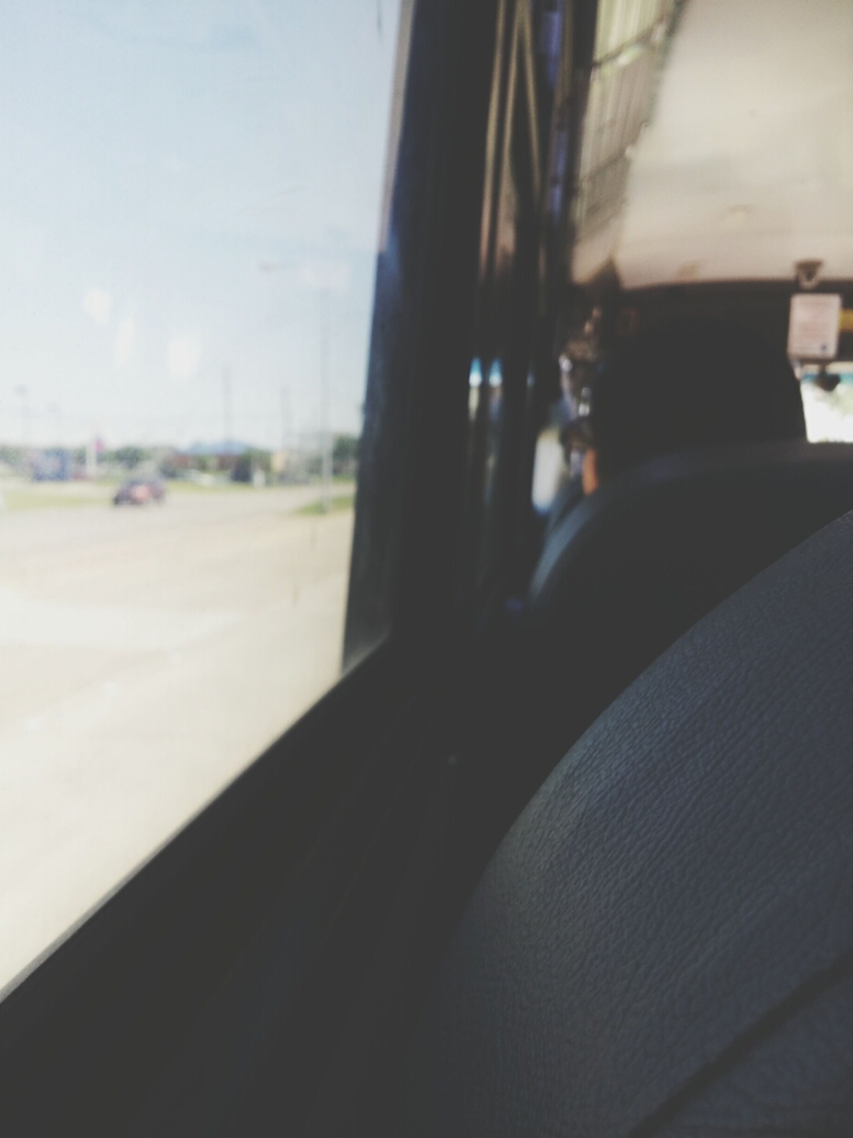 transportation, window, focus on foreground, car, land vehicle, glass - material, mode of transport, transparent, close-up, vehicle interior, part of, sky, day, cropped, road, street, indoors, car interior, selective focus, no people