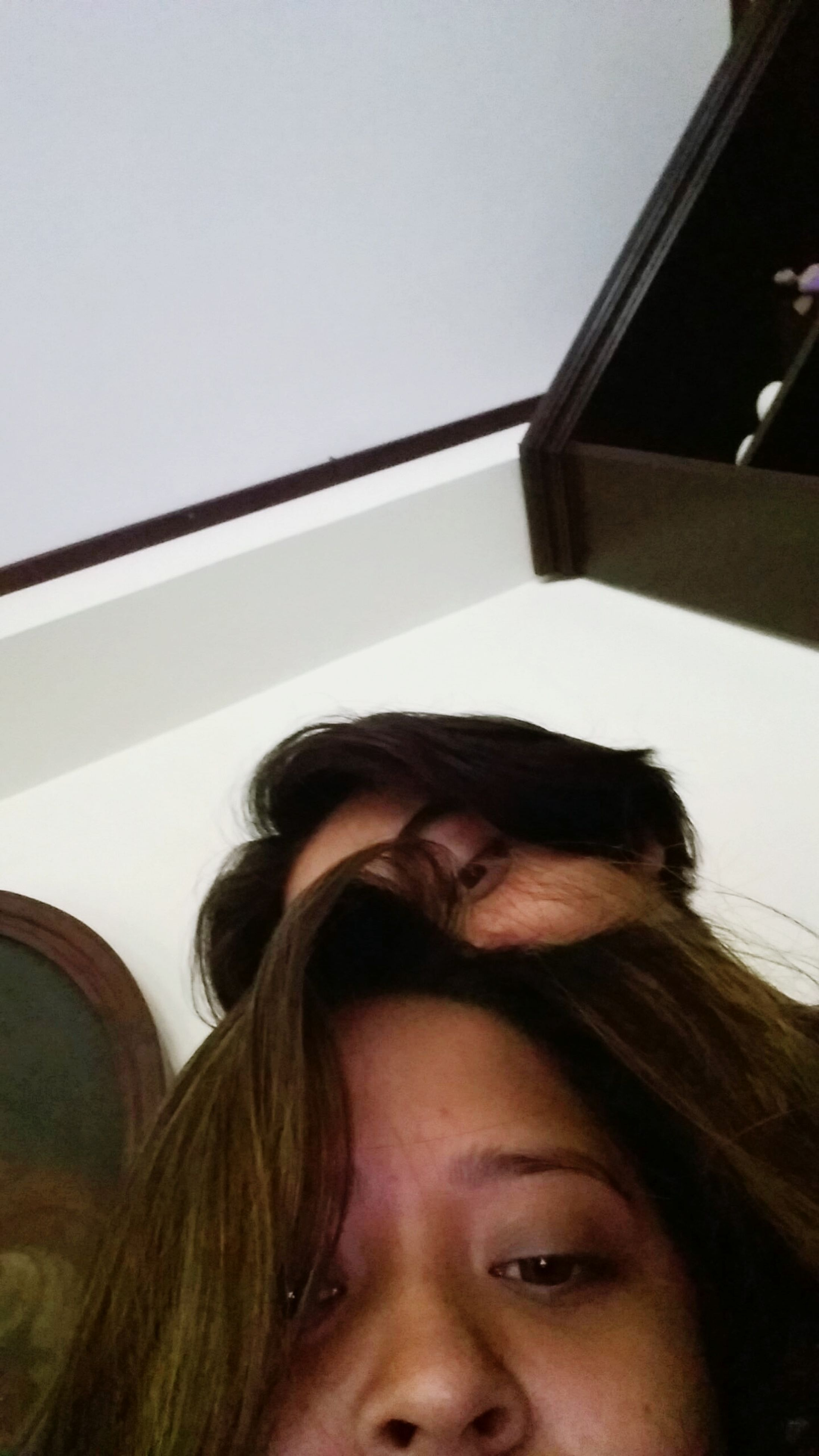 real people, two people, indoors, young women, low angle view, home interior, young adult, leisure activity, day, lifestyles, togetherness, smiling, architecture, close-up