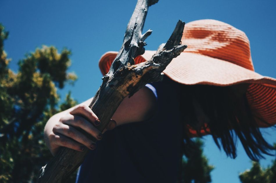 Real People Rifle Gun One Person Weapon Outdoors Holding Focus On Foreground Low Angle View Lifestyles Leisure Activity Day Sky Skill  Men Sunlight Tree Musical Instrument Human Hand Close-up