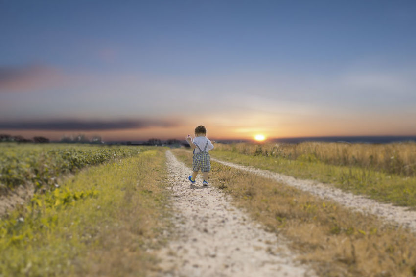 Beauty In Nature Day One Person Outdoors People Sky Sunset Walking