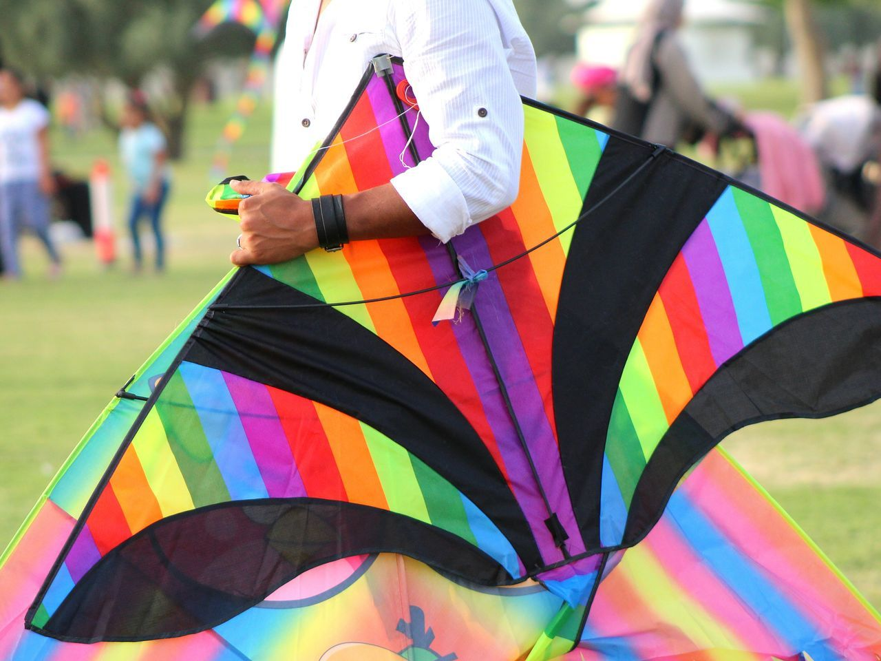 Multi Colored Traditional Festival Celebration Adult People Real People Lifestyles Outdoors One Person Day Kite - Toy Outdoor Activities Kitefestival Kite Springtime
