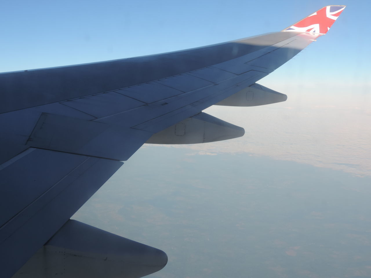 Wing view of a Boeing 747 Virgin Atlantic over the Atlantic Ocean heading to JFK in NYC 747 Aircraft Wing Airplane Airplane Wing Altitude Atlantic Ocean Boeing Flying Journey Mid-air Travel Union Jack Virgin Atlantic Wing View Winglet