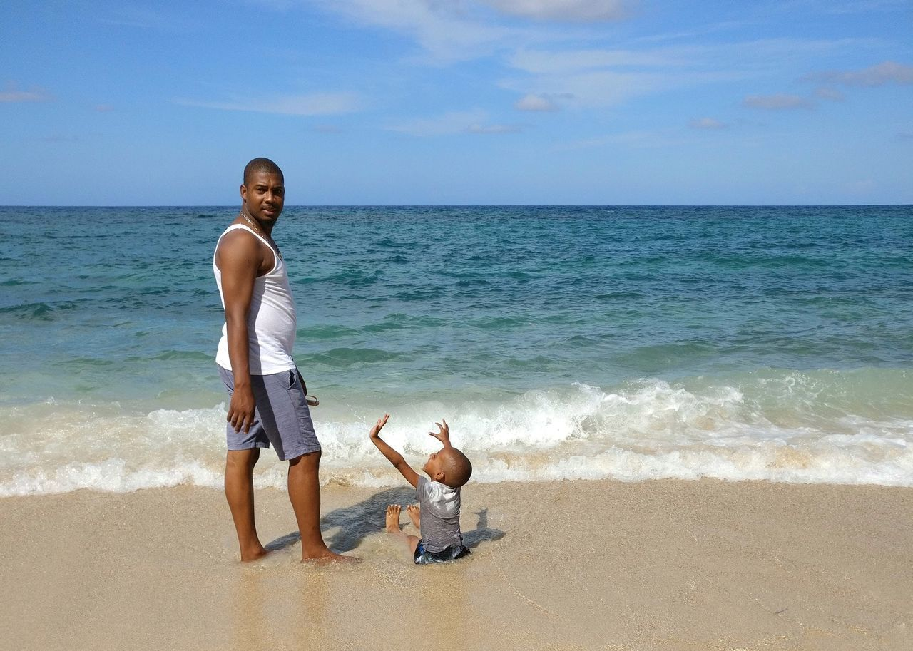 Beach Sea Sand Vacations Child Full Length Water Two People Horizon Over Water Males  Wave Playing Enjoyment Togetherness Outdoors Beach Holiday Summer Leisure Activity Happiness Childhood Parent Father & Son Bamboo Beach Father And Son Rear View