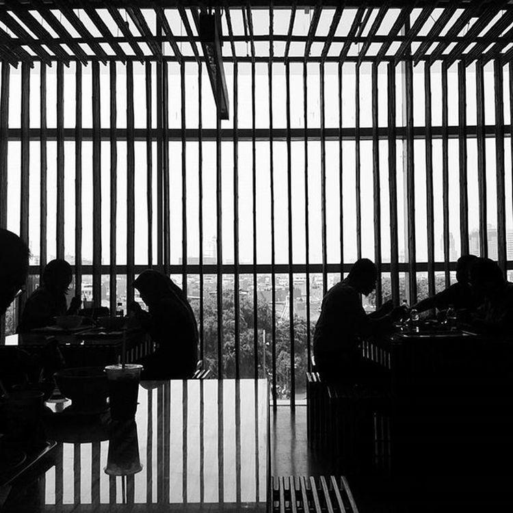 Hidup dalam sangkar Ironi Jakarta Indomaret Onassignment Cage Landscape Dark Window Black Art Shillouette Shadow The Architect - 2016 EyeEm Awards