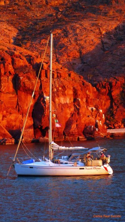 Colour Of Life Boat Sailboat Sail Away, Sail Away At Anchor Baja California Sur Calm Sunset Orange Color Rocks And Water Seascape Trips To Never Forget Trip Trip Photo