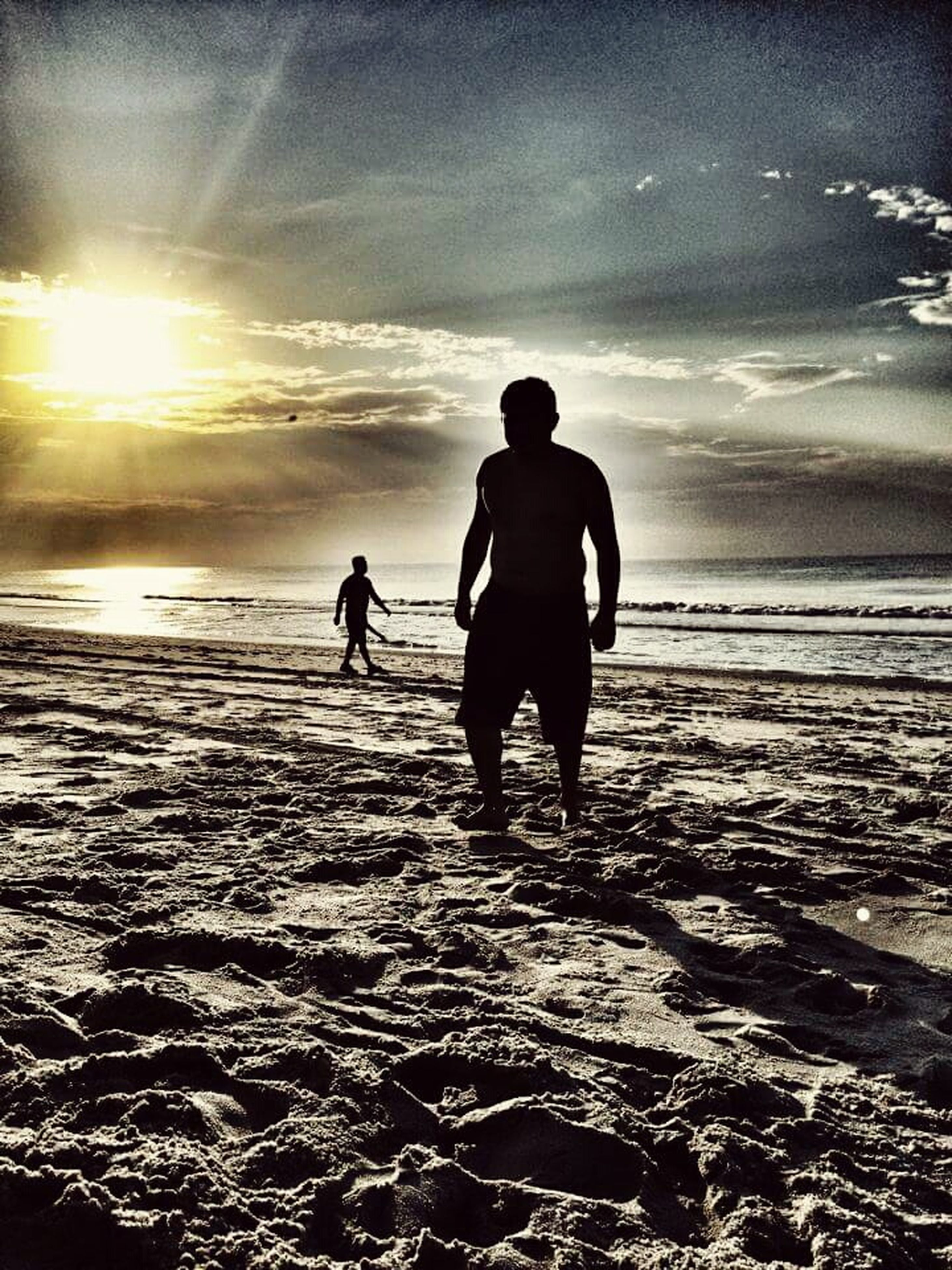 beach, sea, shore, sun, water, lifestyles, leisure activity, sand, sunlight, togetherness, full length, sunset, walking, rear view, sky, men, bonding, boys