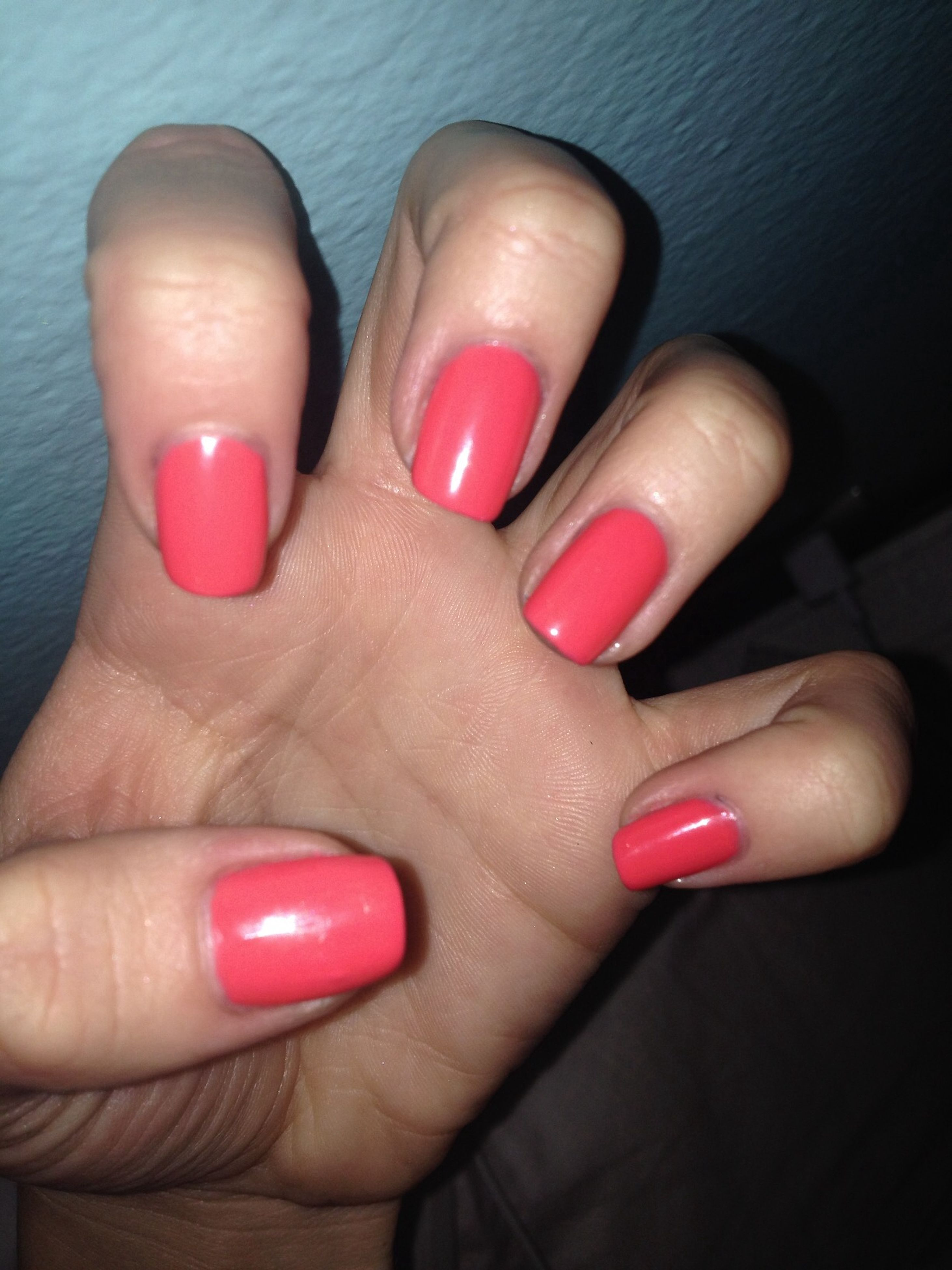 person, part of, indoors, human finger, holding, cropped, red, personal perspective, nail polish, high angle view, unrecognizable person, close-up, lifestyles, multi colored, leisure activity, fashion