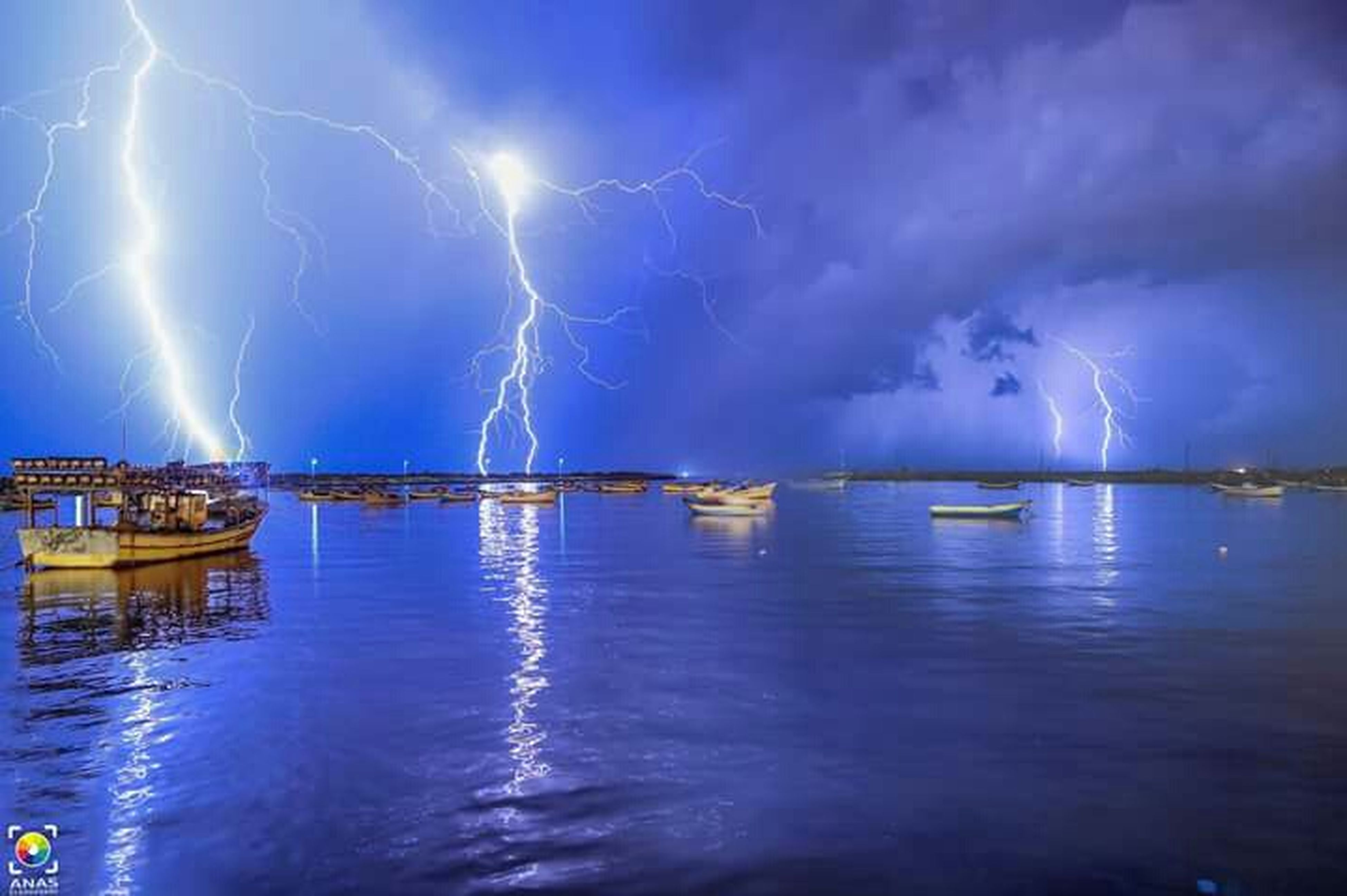 water, sky, nautical vessel, sea, cloud - sky, transportation, boat, mode of transport, waterfront, scenics, reflection, cloudy, beauty in nature, tranquility, illuminated, blue, tranquil scene, nature, moored, night