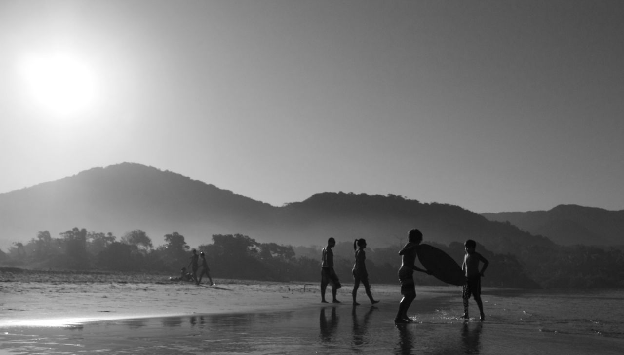 mountain, water, beach, nature, beauty in nature, scenics, real people, leisure activity, sand, outdoors, sky, vacations, men, sea, lifestyles, large group of people, sport, day, people