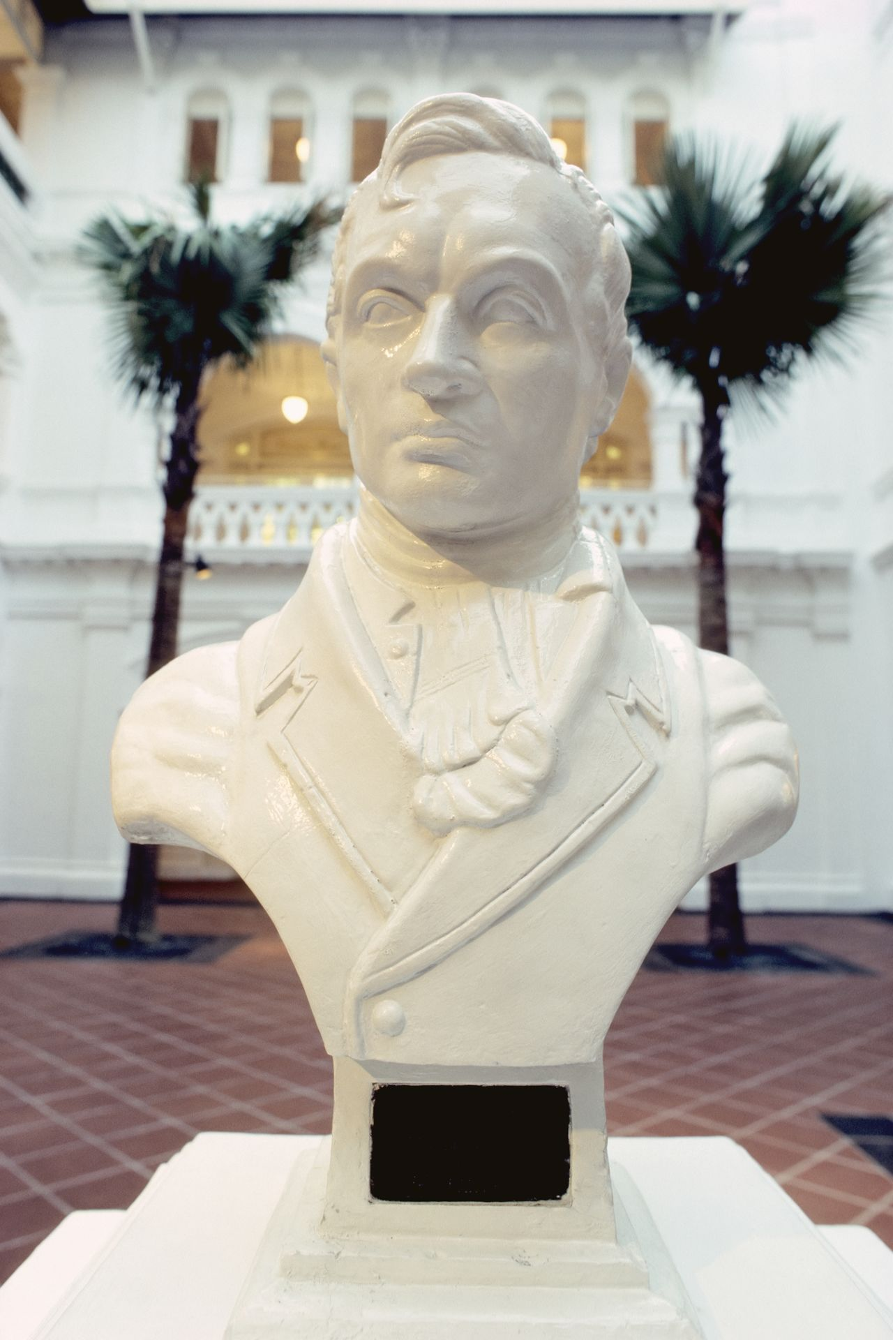 Raffles bust at the Raffles Hotel Architecture Art & Craft Bust  Colonialism Inner Yard Palm Trees Raffles Hotel  Raffles Singapore Southeast Asia Vertical White Color