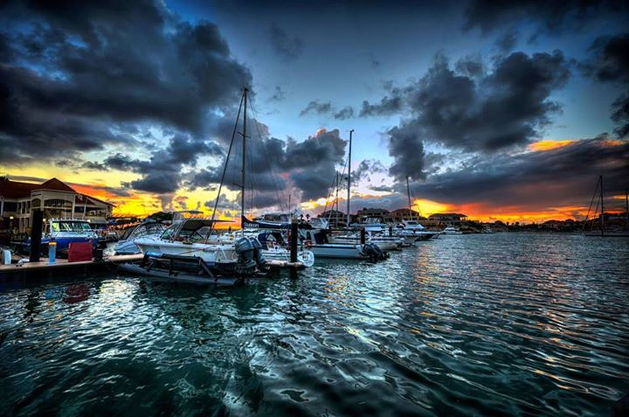 water, nautical vessel, transportation, sky, cloud - sky, mode of transport, sunset, waterfront, boat, cloudy, moored, sea, cloud, harbor, mast, weather, rippled, nature, dramatic sky, scenics