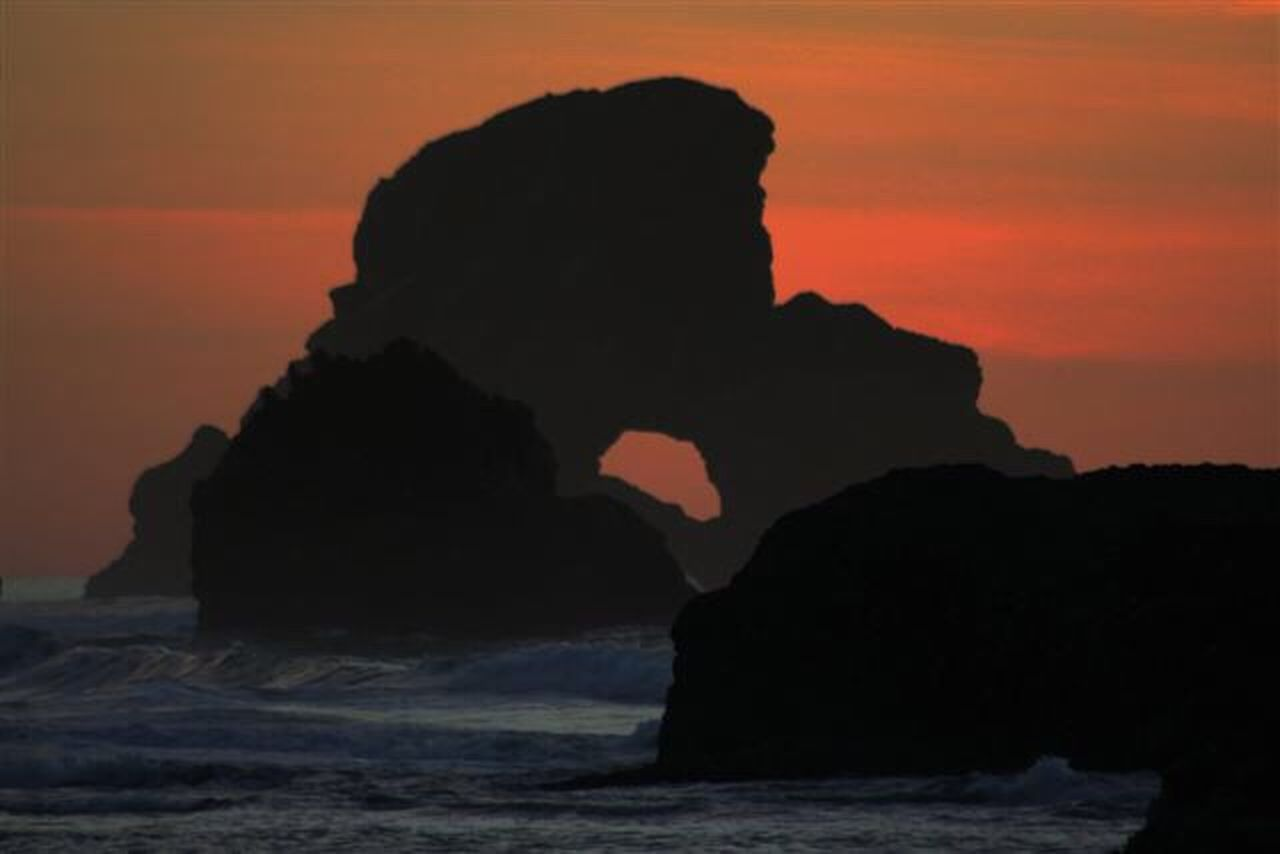 sea, rock - object, rock formation, geology, nature, scenics, silhouette, lava, sunset, beauty in nature, tranquility, no people, outdoors, physical geography, cliff, water, horizon over water, sky, day