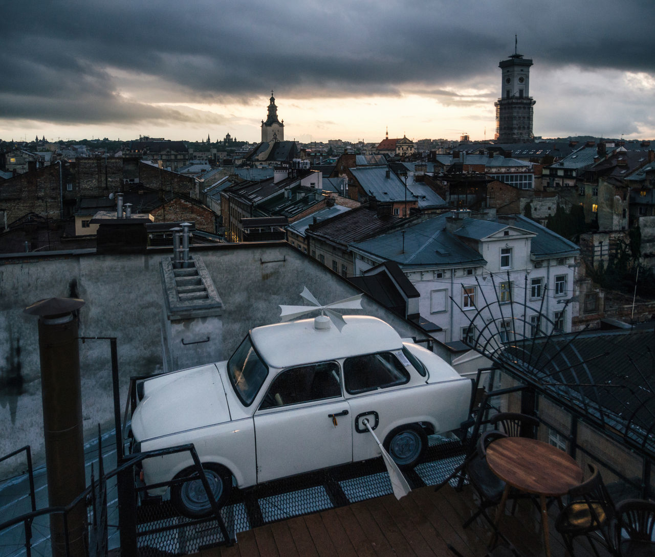 Trabant car parked on the roof a historic building House of Legends in the dusk. Landmark of Lviv, Ukraine. Architecture Building Exterior Built Structure Car City Cityscape Cloud - Sky Land Vehicle Lviv Mode Of Transport No People Outdoors Residential Building Roof Sky Sunset Town Trabant Transportation Ukraine