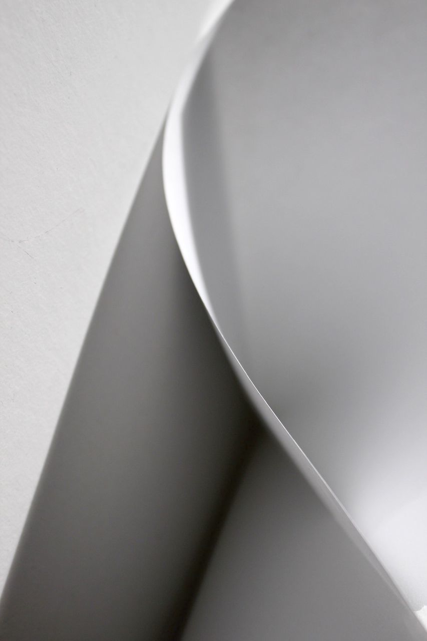 Cropped Image Of Paper On Table