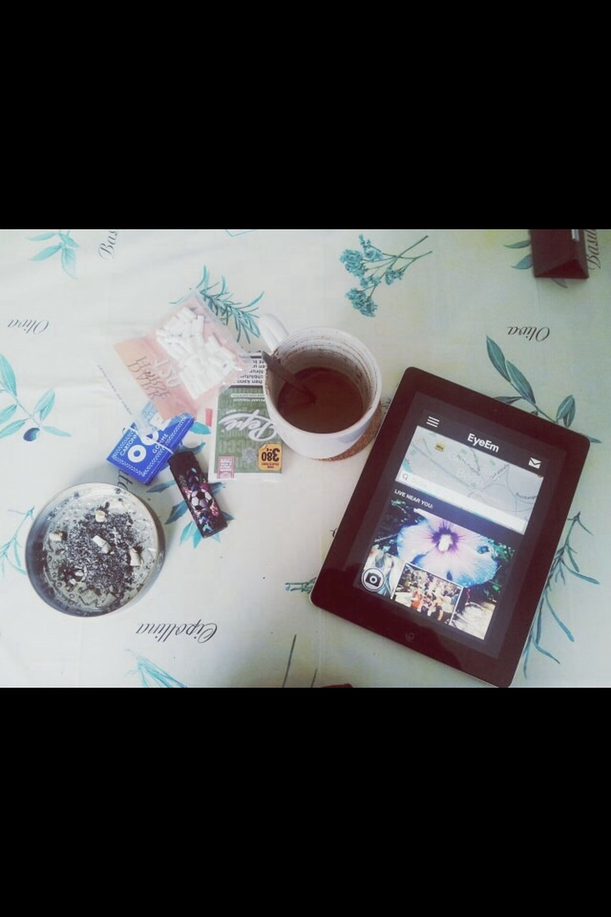 indoors, table, transfer print, communication, auto post production filter, still life, text, coffee cup, high angle view, western script, technology, drink, close-up, cup, food and drink, wireless technology, no people, paper, refreshment, coffee - drink