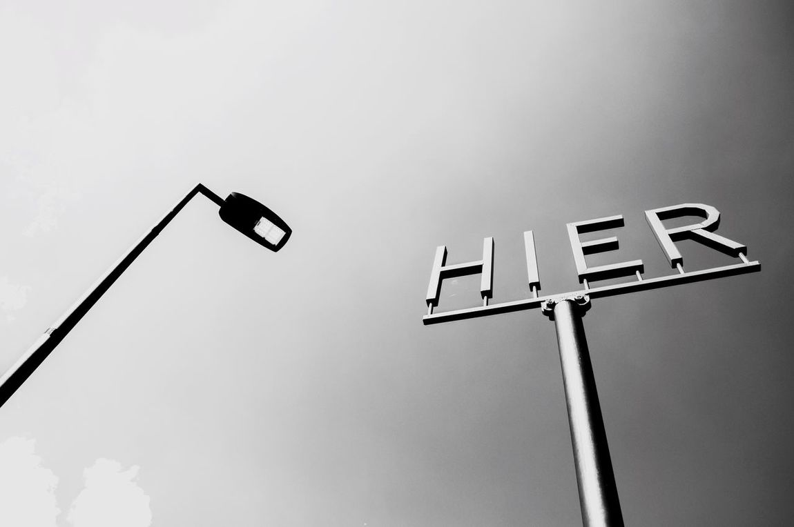 Here! Sky Clouds Hier Here Streetphotography Streetlights Guidance Low Angle View Look Up Communication High Section No People Nikon Composition Blackandwhite Silver  LINE