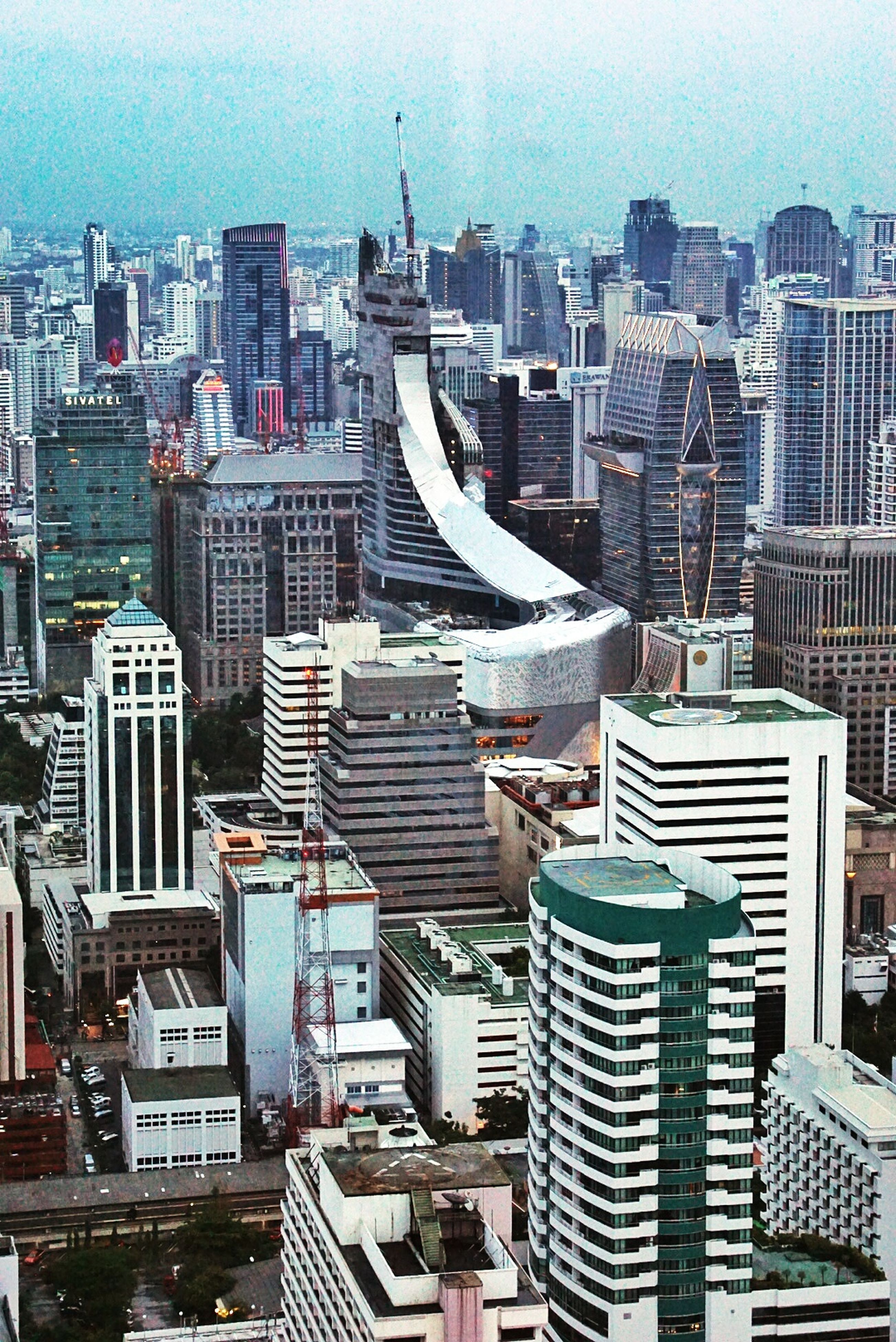building exterior, architecture, built structure, city, cityscape, crowded, high angle view, skyscraper, modern, residential district, office building, residential building, sky, tower, residential structure, roof, tall - high, city life, day, outdoors