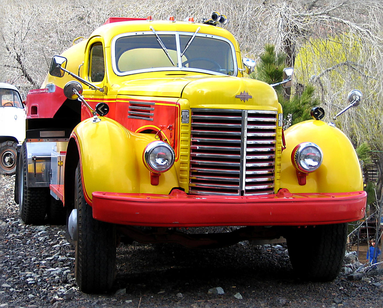 yellow, land vehicle, mode of transport, headlight, transportation, retro styled, outdoors, day, golden color, no people