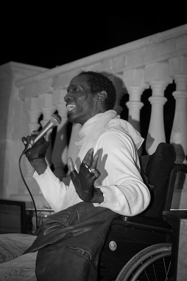 Arts Culture And Entertainment Black And White Black People Charles Role Concert Live Live Music Mallorca Music Musician One Person Peguera Performance Singer  Singing Sitting Wheelchair The Portraitist - 2017 EyeEm Awards