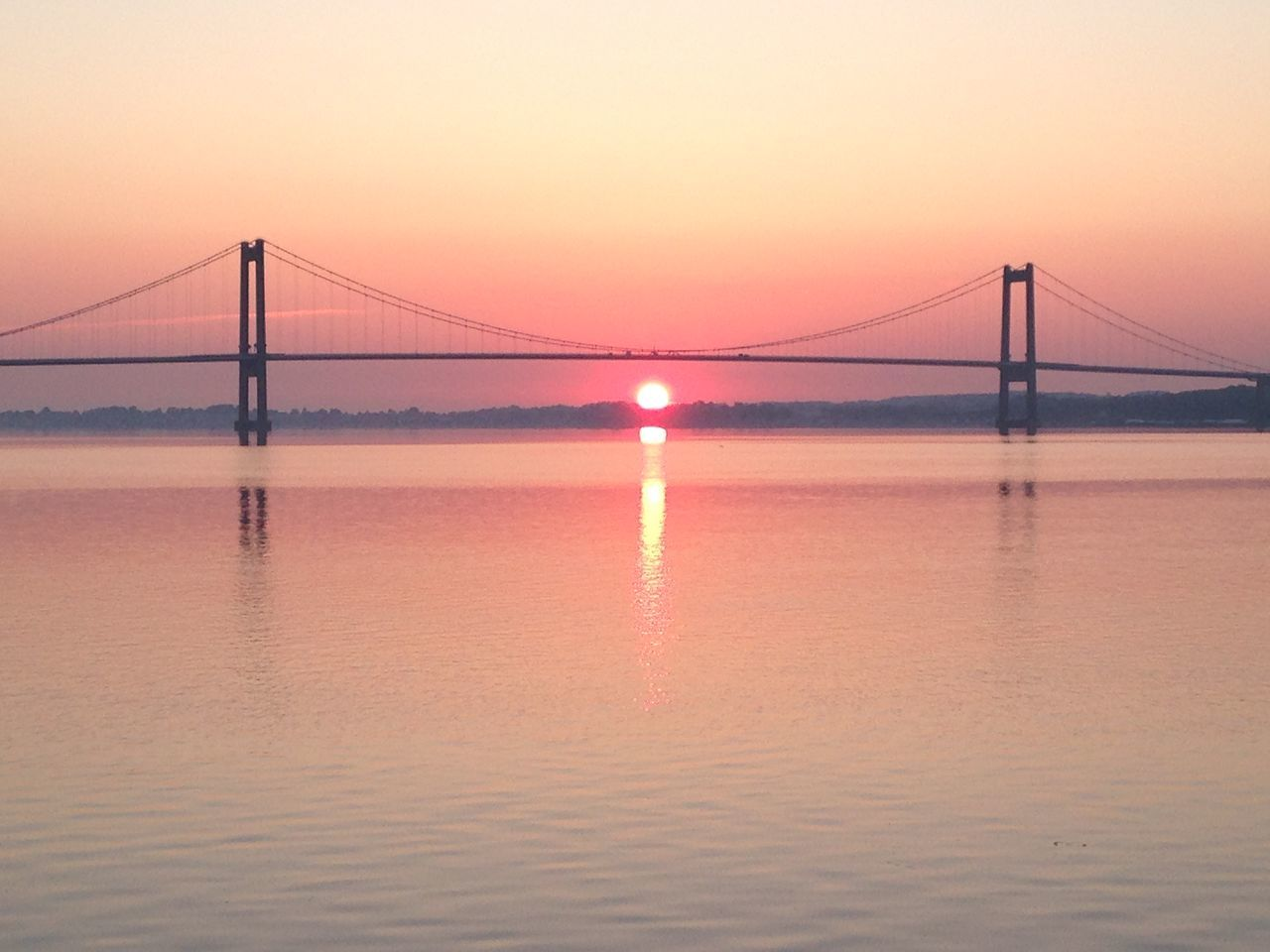 suspension bridge, bridge - man made structure, connection, engineering, sunset, tourism, sea, transportation, water, travel destinations, travel, architecture, sky, outdoors, built structure, nature, bridge, no people, beach, scenics, beauty in nature, horizon over water, day