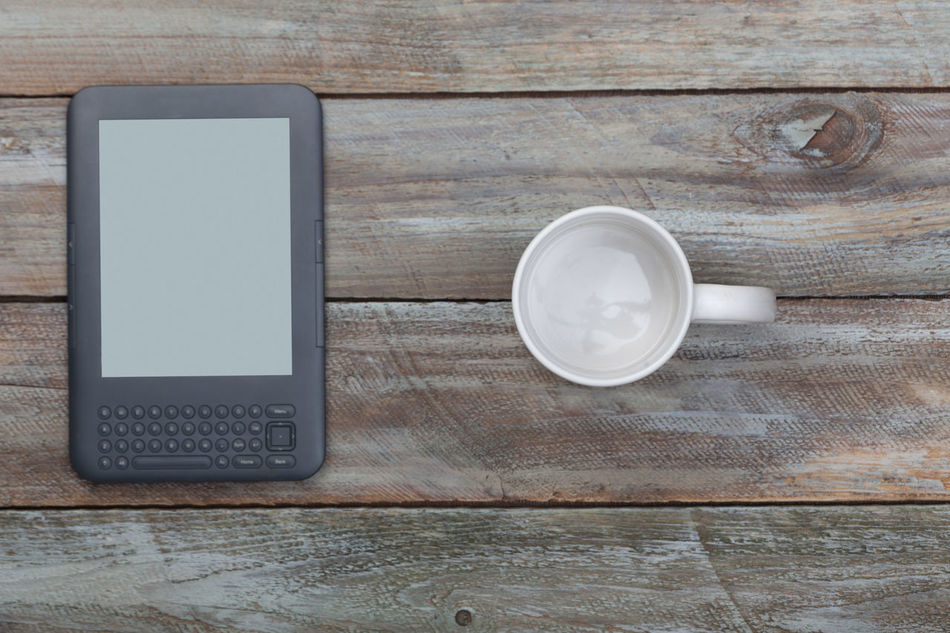 Empty coffee mug and ebook reader on wood table with copy space Bird's Eye View Books Coffee Concept Copy Space Cup Desktop Device E-book Reader Ebook Electronics  Empty High Angle View Modern Mug No People Nobody Reader Reading Still Life Table Vintage Wood