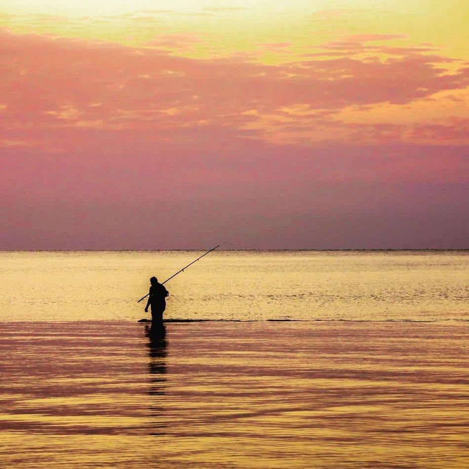 Water Silhouette Sea Nature One Person Sunset Horizon Over Water Tranquil Scene Beauty In Nature Scenics Standing Outdoors Real People Men Tranquility Sky Fishing Pole Day One Man Only People