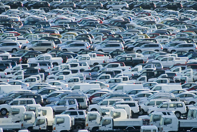 rows of new cars waiting to be delivered Auto Automotive Busy Car Cars City Life Lots Many Motocar New Overcrowded Parked Parking Lot Pattern Rows Transportation Windows Windscreens