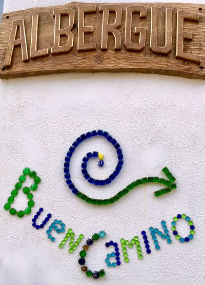 Wishing you a buen camino Arrow Camino Greeting Sign Signs Accommodation Albergue Best Wishes Close-up Colorful Communication Day Direction Good Wishes Journey No People Pilgrimage Text Wooden Words