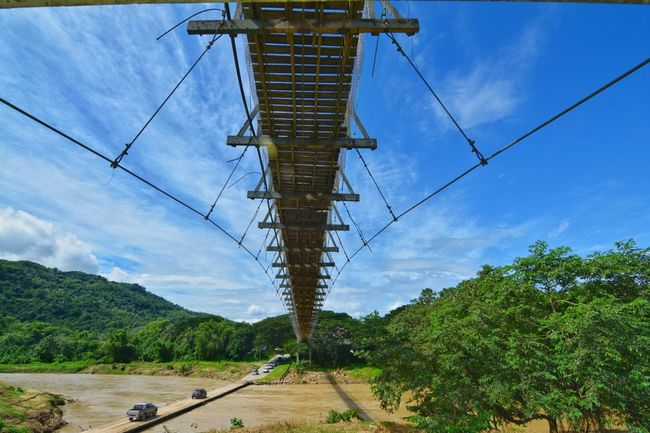 Feel The Journey ..Tamparuli Bridge in Sabah Malaysia . Wooden Hanging Bridge across River Suspended Bridge Tourist Attraction  Travel Dramatic Angles