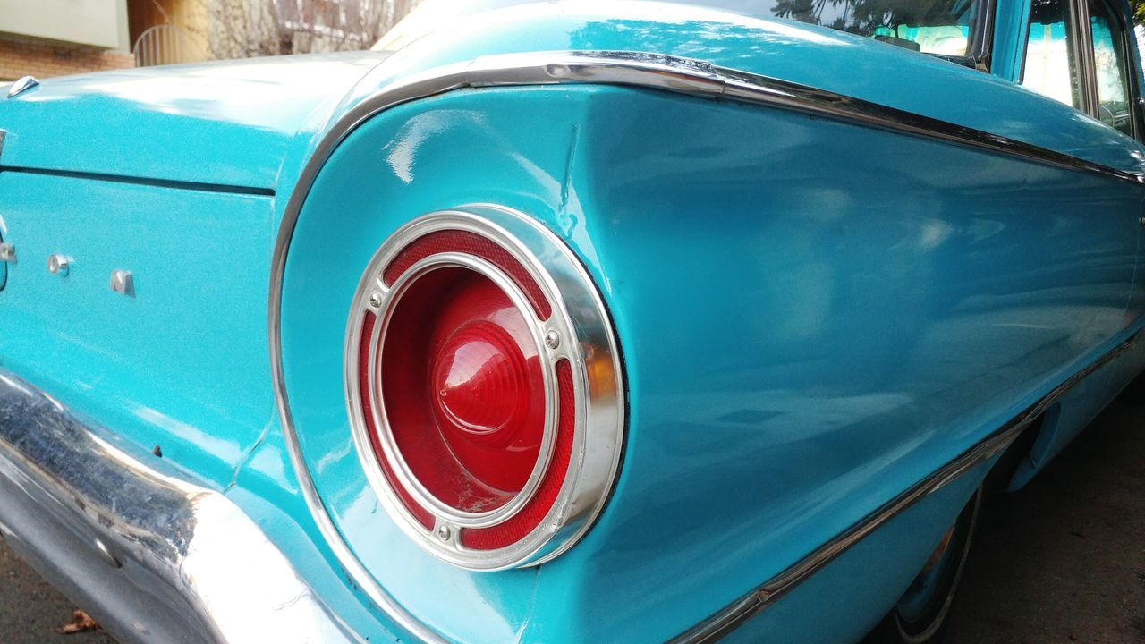 classic car details - chrome trim, sky blue, and a red taillight. Classic Car Taillight Chrome Detail Car Transportation Mode Of Transport Vintage Car Land Vehicle Retro Styled Old-fashioned Collector's Car No People Red Blue