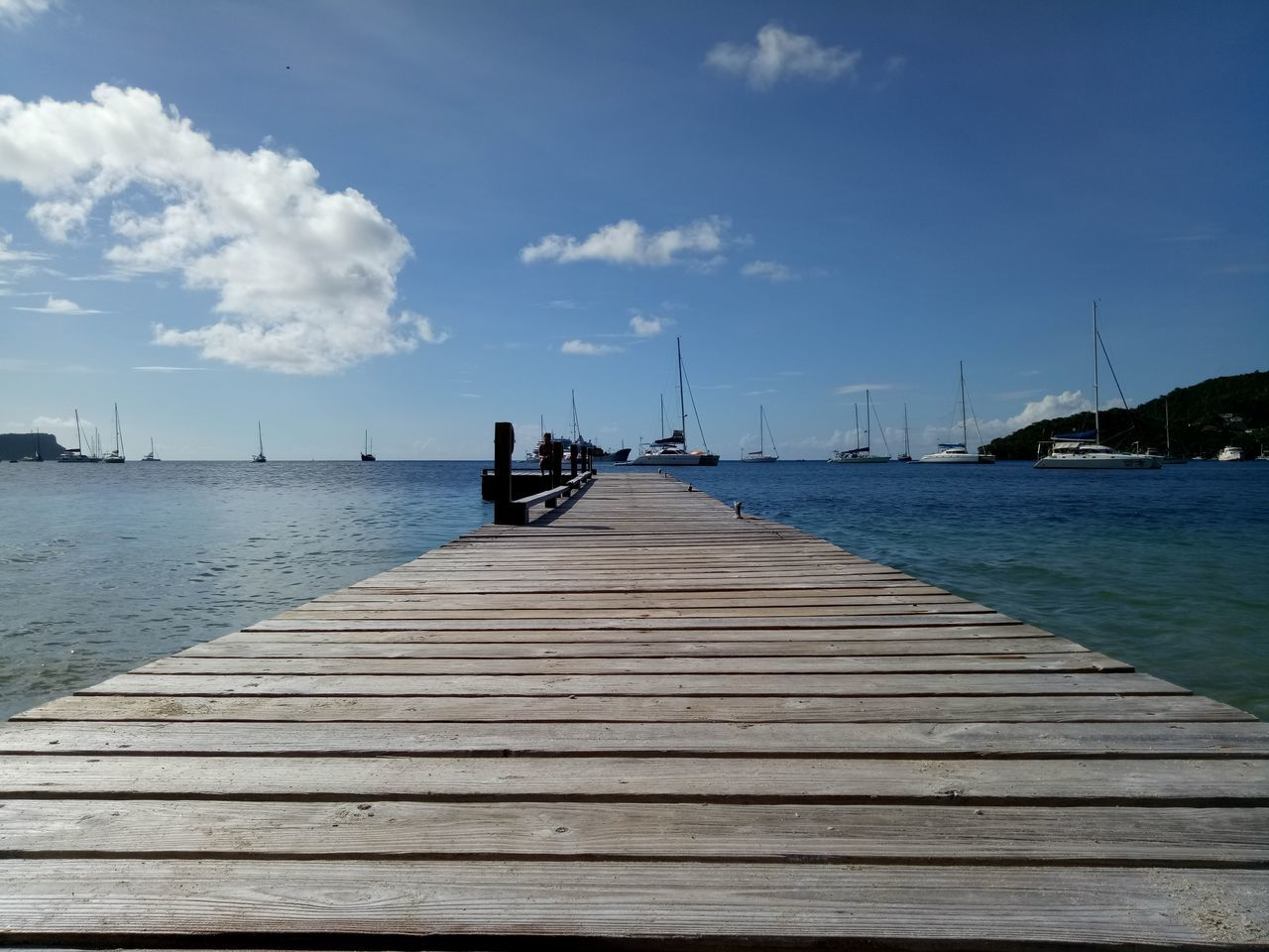 Sea Pier Blue Sky Water Outdoors Vacations Summer Boardwalk Nature Social Issues Beach Natural Disaster Landscape One Man Only Human Body Part One Person Scenics Day Horizon Over Water