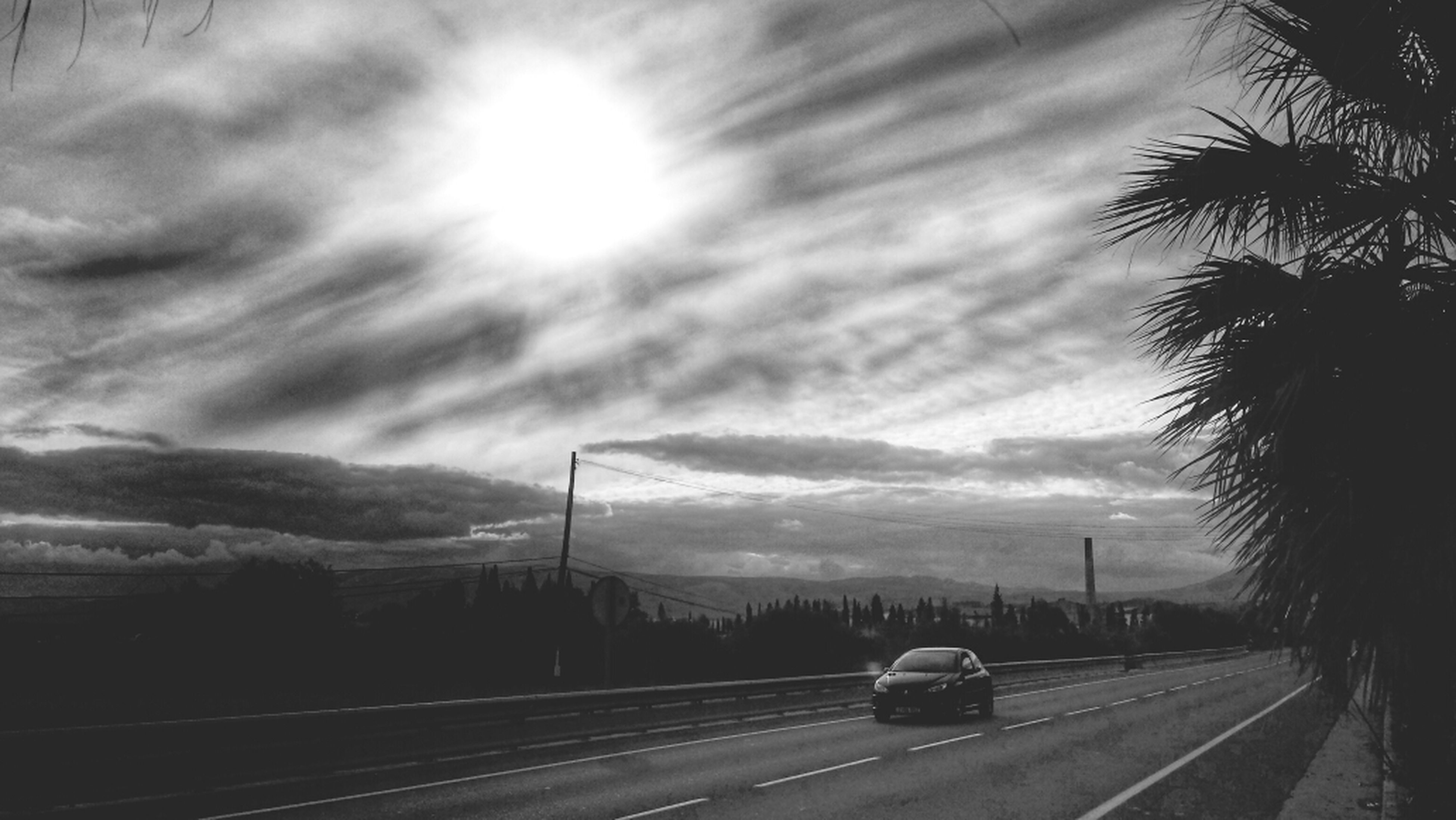 transportation, sky, road, cloud - sky, the way forward, cloudy, road marking, silhouette, car, cloud, tree, electricity pylon, street, railroad track, land vehicle, nature, diminishing perspective, connection, highway, mode of transport