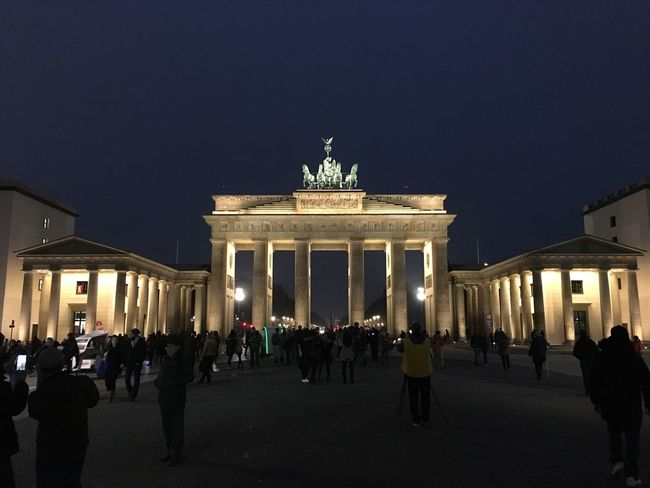 City Gate Architecture Illuminated Built Structure Large Group Of People Travel Destinations City Sky Real People Night Outdoors Statue Crowd People Brandenburg Gate