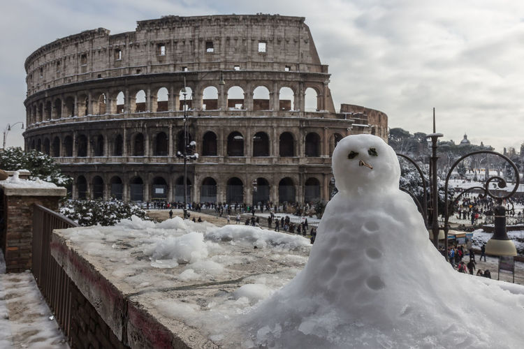 Colosseum with snow Rome Travel Winter Ancient Ancient Civilization Arch Architecture Beautiful Places Building Exterior Built Structure Cloud - Sky Coluseum Day History Italy No People Old Ruin Outdoors Season  Sky Snow The Past Tourism Tourism Destination Travel Destinations
