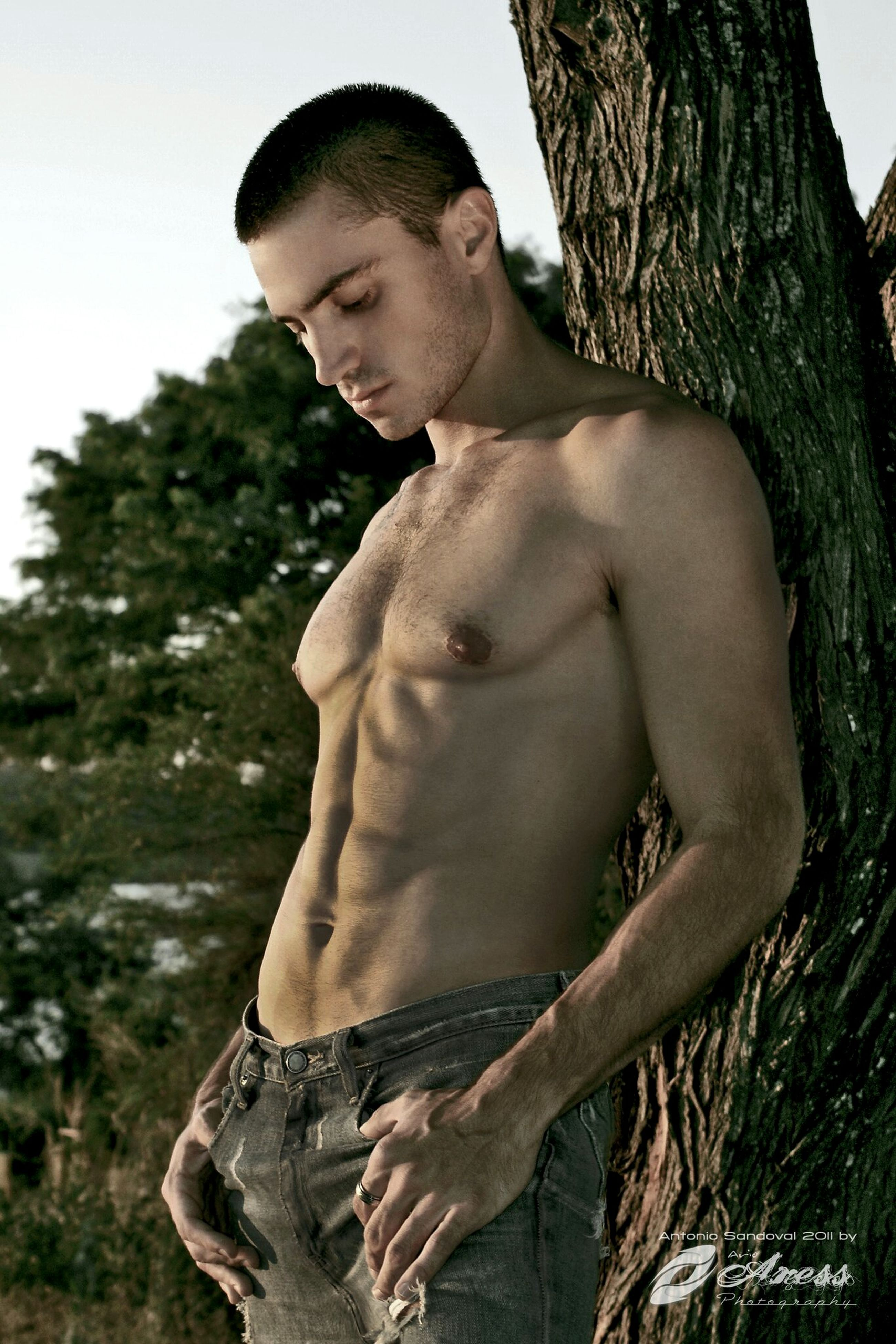young adult, person, young men, lifestyles, leisure activity, front view, looking at camera, portrait, shirtless, casual clothing, mid adult, tree, low angle view, standing, outdoors, mid adult men, day