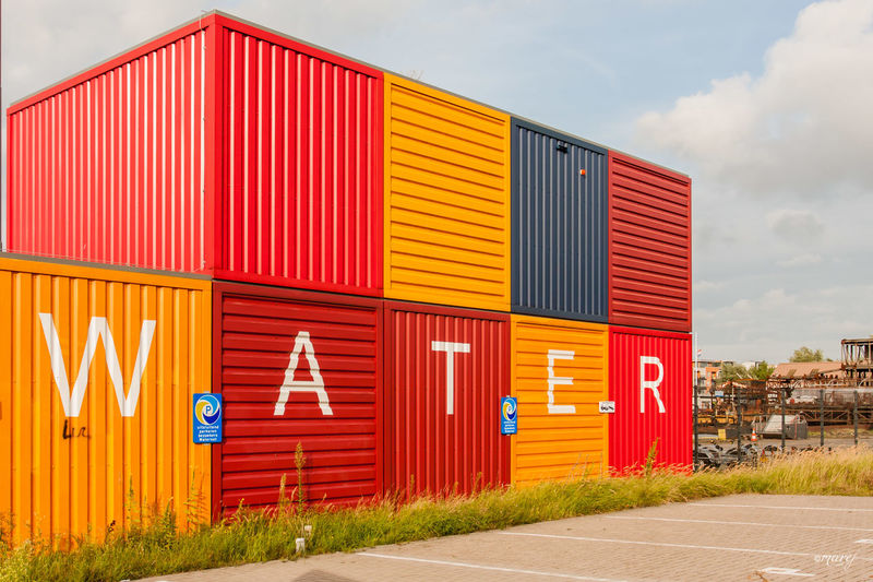 Colored cubes under the sky Yellow Architecture Corrugated Iron Outdoors Multi Colored Built Structure Commercial Sign Yellow Color City Life Eyemphotography Canon_official Eye4photography  Canon Eye4photography  EyeEm Gallery Canon_photos Eye4photography  The Week Of Eyeem Canonphotography Holland Holland❤ Olanda The Great Outdoors - 2016 EyeEm Awards Working Amsterdam