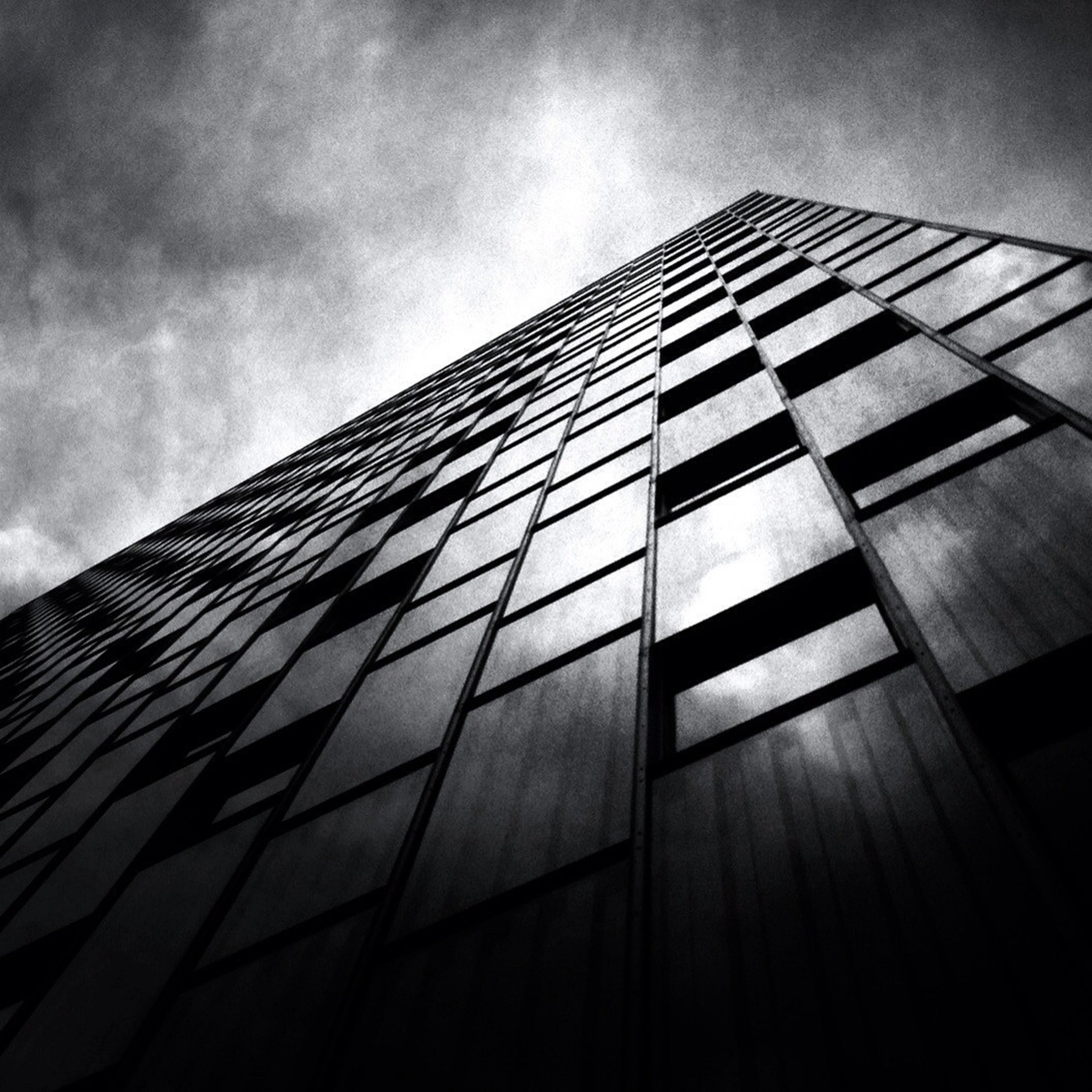 architecture, building exterior, built structure, low angle view, modern, office building, skyscraper, city, tall - high, sky, building, glass - material, tower, reflection, window, day, tall, cloud - sky, no people, outdoors
