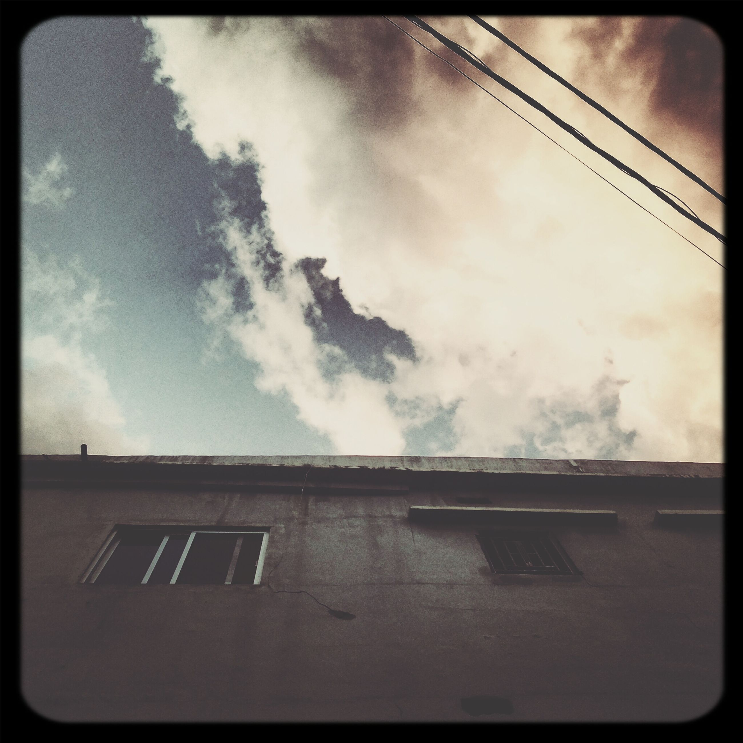 transfer print, architecture, building exterior, built structure, low angle view, sky, auto post production filter, cloud - sky, cloudy, cloud, building, residential structure, day, outdoors, house, residential building, no people, high section, window, power line