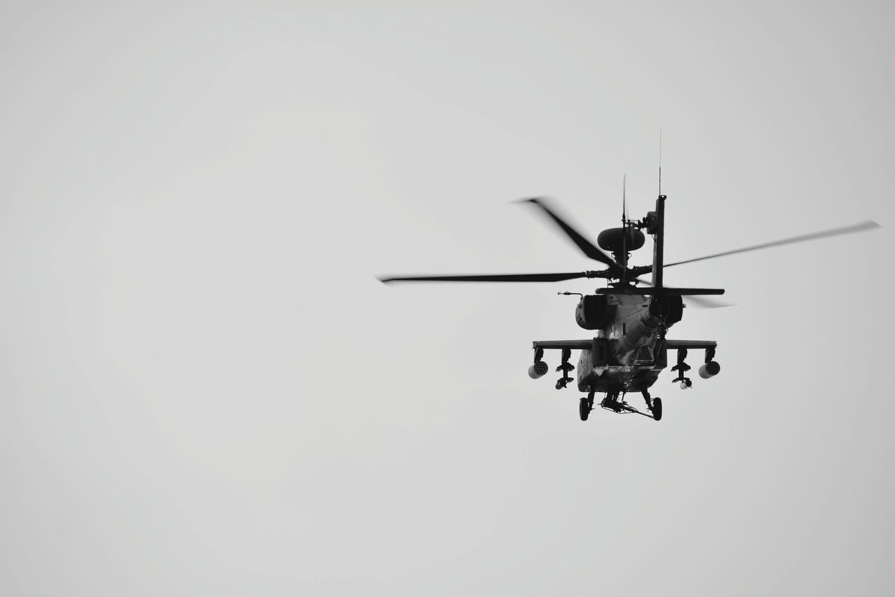 low angle view, helicopter, air vehicle, transportation, mode of transport, flying, clear sky, outdoors, day, mid-air, sky, no people