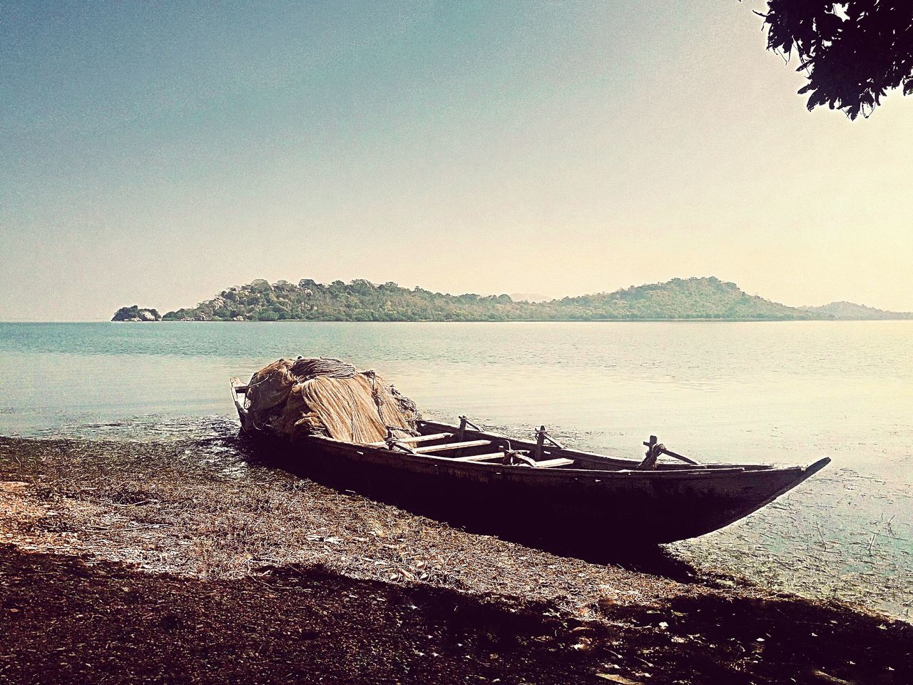 water, nature, tranquility, nautical vessel, sea, tranquil scene, scenics, beauty in nature, beach, outdoors, clear sky, no people, sky, moored, day, horizon over water, tree