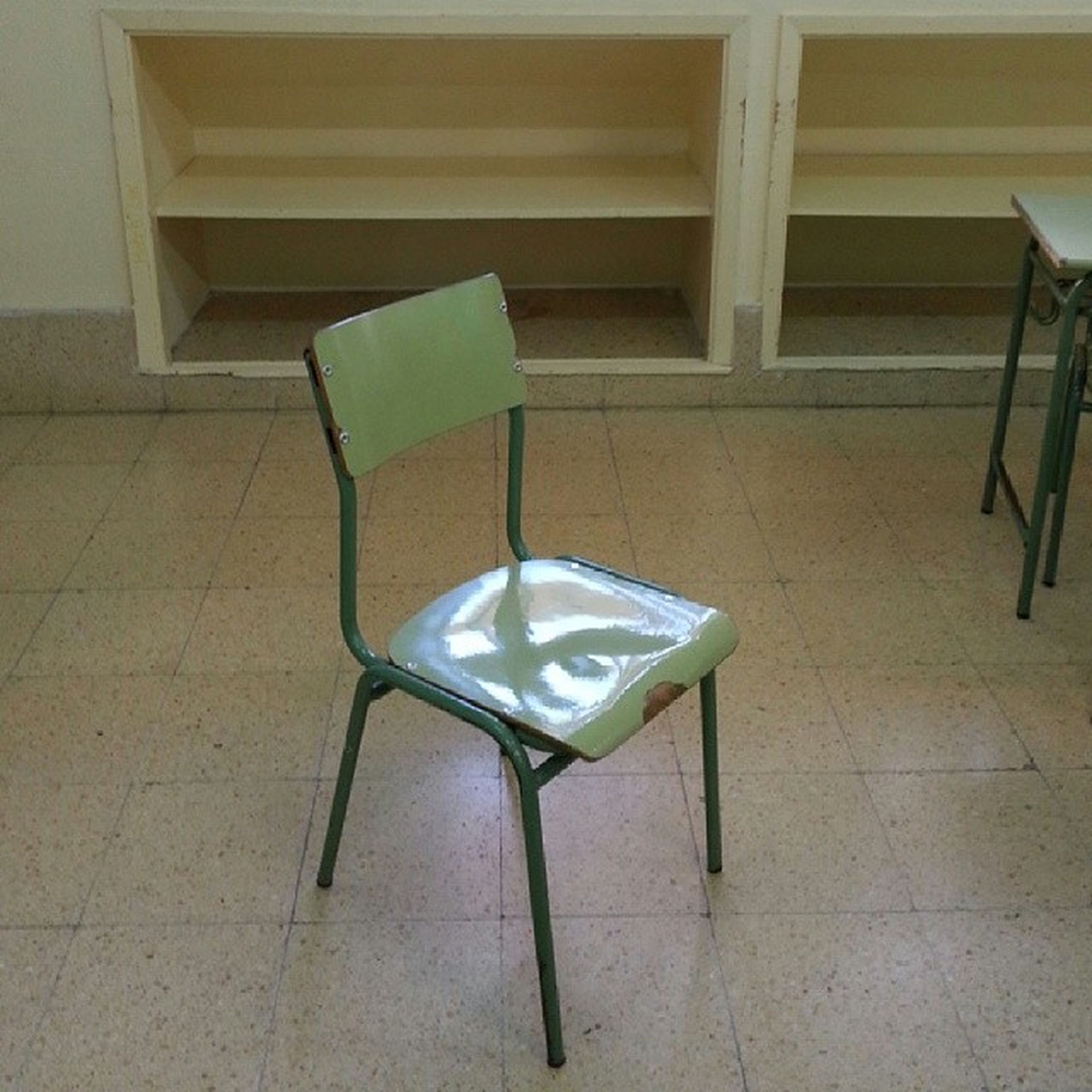 chair, indoors, absence, empty, table, still life, furniture, tiled floor, flooring, wall - building feature, high angle view, seat, architecture, no people, built structure, shadow, wood - material, wall, home interior, sunlight