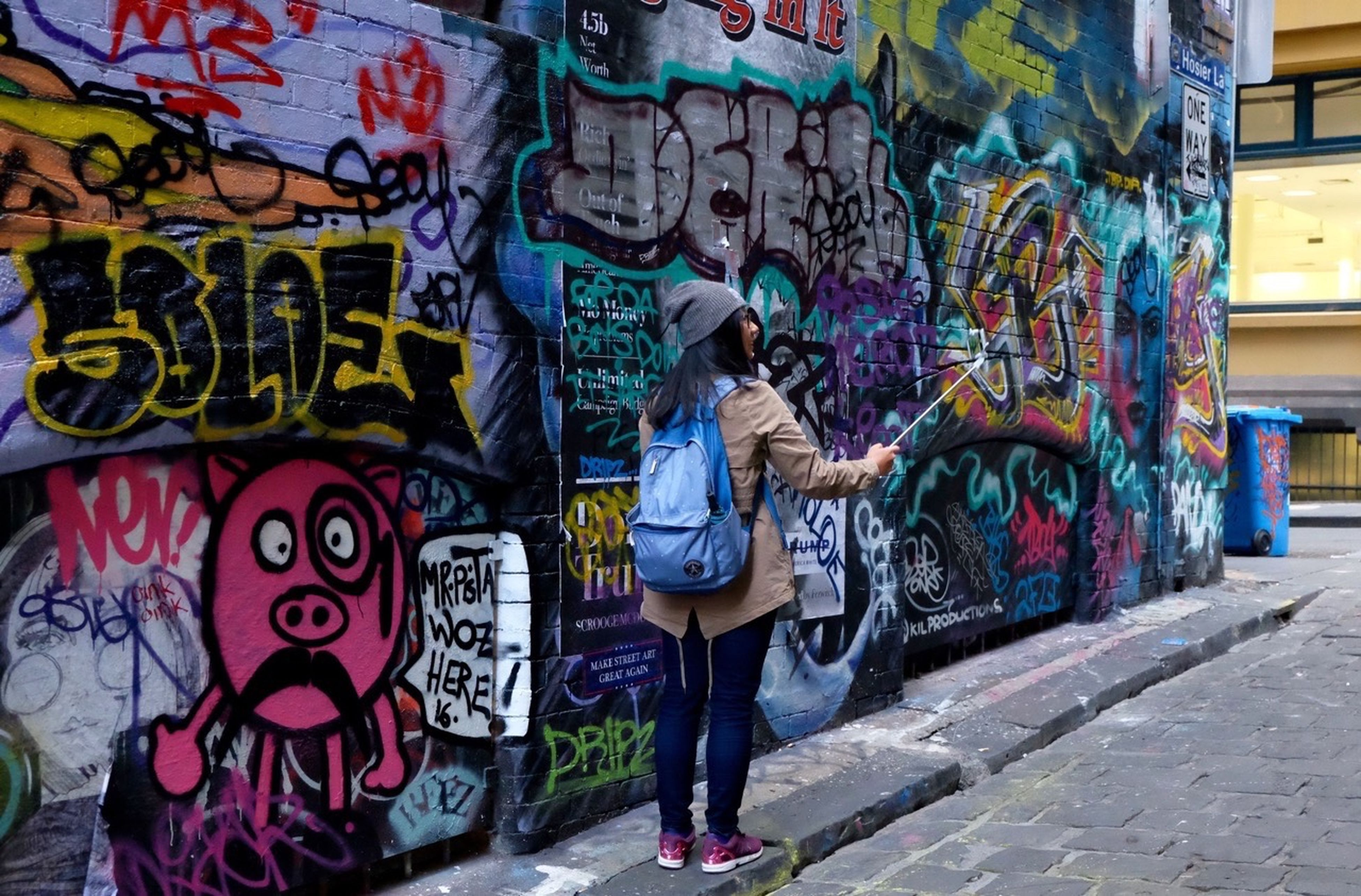 graffiti, art, creativity, multi colored, built structure, wall - building feature, architecture, street art, lifestyles, painting, casual clothing, store, day, outdoors