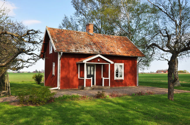 Typically swedish summer house. Red cottage. Architecture Built Structure Cloud Cottage Countryside Day Façade Field Garden Grass Green Color House Landscape Nature No People Outdoors Red Rural Scene Sky Summer House Swedish Tranquil Scene Tree Typically