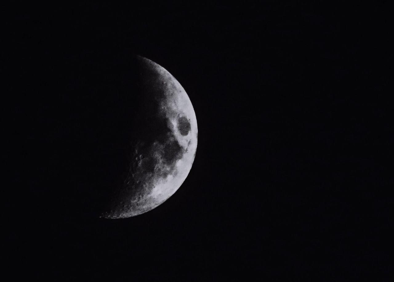 Waxing Crescent In Black Sky