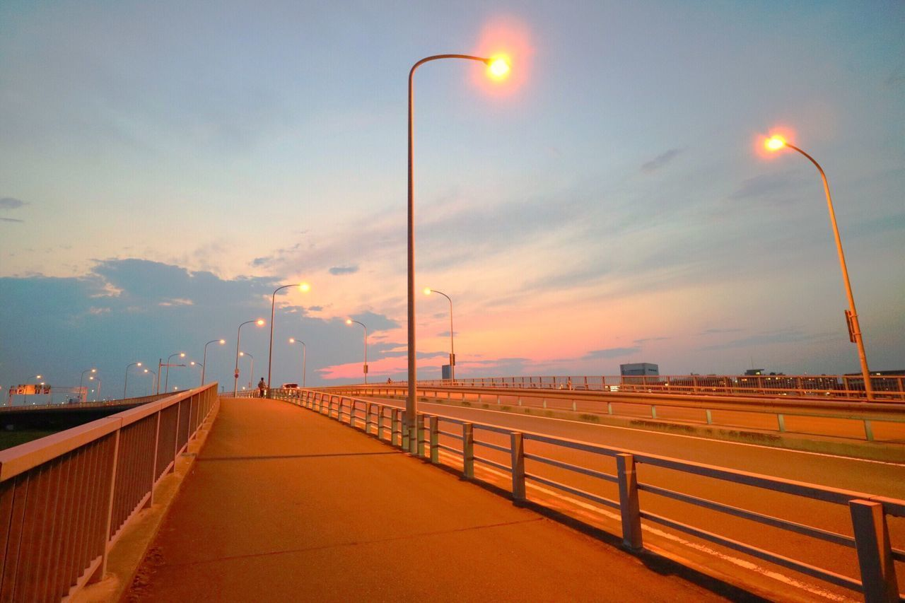 Sunset Street Light Railing Lighting Equipment Sky Illuminated No People Cloud - Sky Built Structure Outdoors Architecture Nature Day