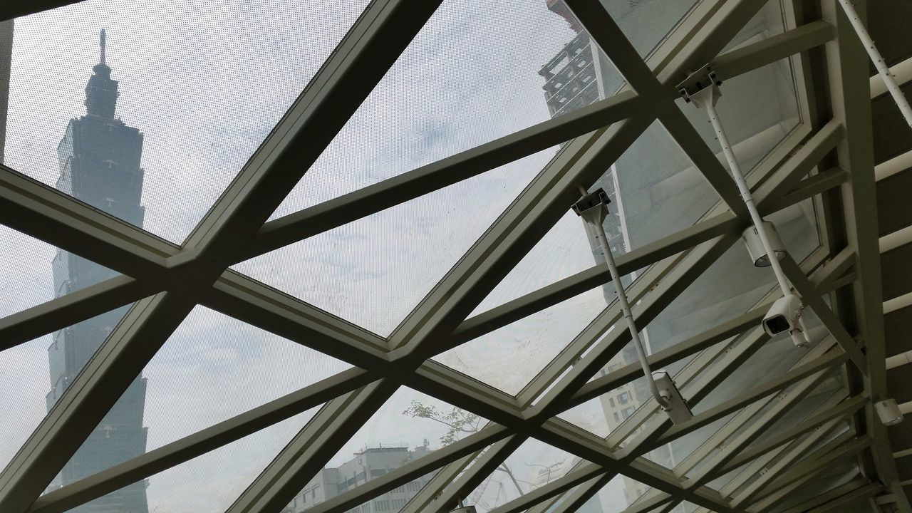 architecture, built structure, window, low angle view, indoors, building exterior, day, pattern, no people, cloud - sky, sky
